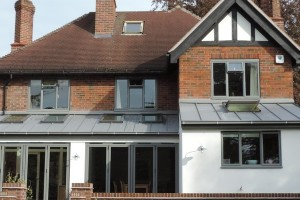 Full width glazed extension with zinc roof
